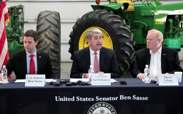 The U.S. Department of Agriculture's undersecretary for trade, Ted McKinney, speaks at a roundtable discussion Wednesday in Omaha, Nebraska. He's flanked by GOP U.S. Sen. Ben Sasse (left) and Nebraska Farm Bureau President Steve Nelson.