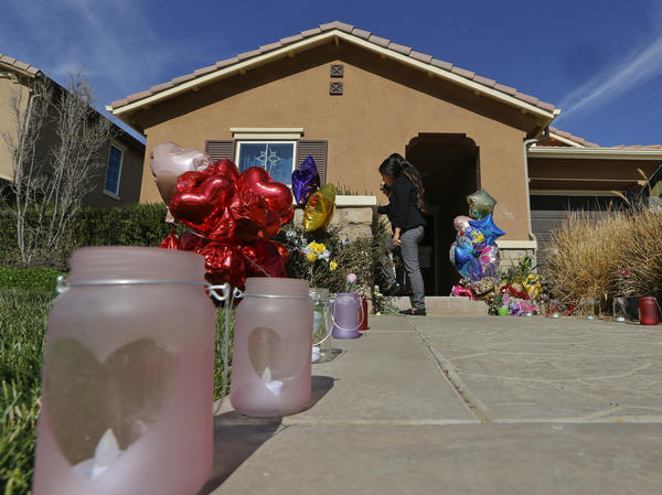 Neighbors write down messages for the Turpin children on the front door of the home of David and Louise Turpin in Perris, Calif. Police arrested the couple accused of holding their 13 children, ranging from 2 to 29, on Jan. 14, 2018. The children were home-schooled.