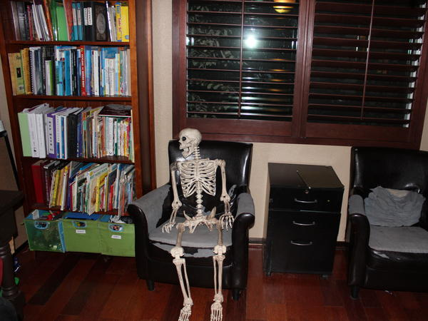 """Dead Tom"" lounges in the Grozas' computer room. The Groza kids use Dead Tom to learn human anatomy."