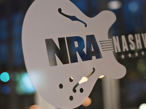 A sign touts the 144th National Rifle Association annual meetings and exhibits. The NRA may have more Russian or foreign members than it first acknowledged.
