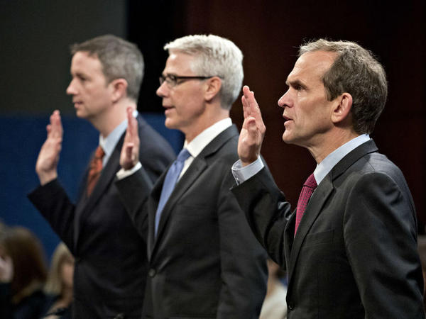 From right: Kent Walker, vice president and general counsel with Google Inc.; Colin Stretch, general counsel with Facebook Inc.; and Sean Edgett, acting general counsel with Twitter Inc., swear in to a House Intelligence Committee hearing in Washington, D.C., on Nov. 1, 2017.