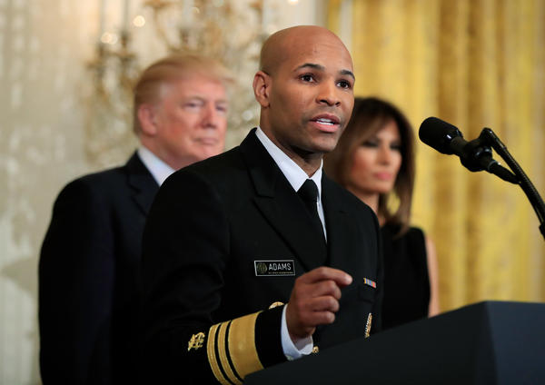 In this Feb. 13, 2018, file photo, Surgeon General Jerome Adams speaks during a National African American History Month reception hosted by President Donald Trump and first lady Melania Trump in the East Room of the White House in Washington.