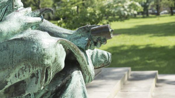 Young Sam Colt is depicted devising the revolving bullet chamber of his pistol. Colt did not invent the revolver, but he developed it into a practical weapon.