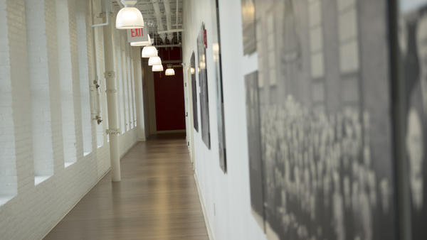 A hallway in one of the renovated Colt factory buildings is lined with historical photos from it's days as a manufacturing center.