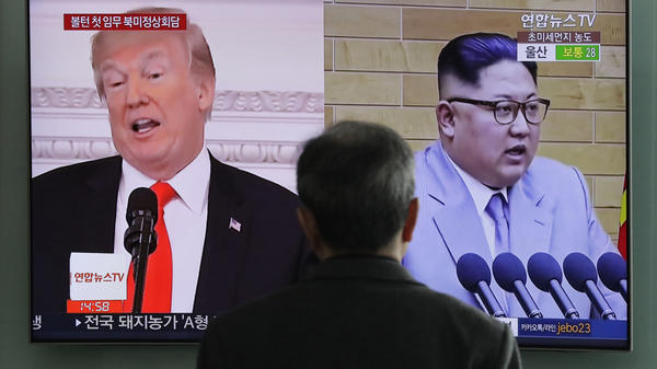 A man watches a TV screen showing archival video of President Trump and North Korean leader Kim Jong Un, during a news program at the Seoul Railway Station in Seoul, South Korea, last month.