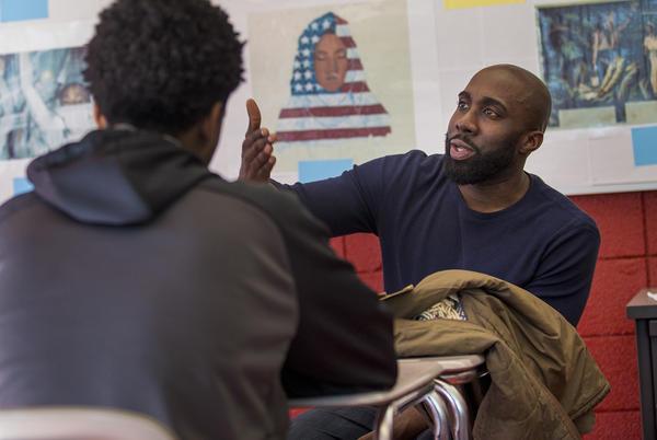 CRLS history teacher Kevin Dua speaks with students of the Black Student Union. (Jesse Costa/WBUR)