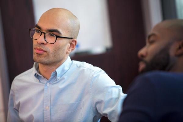 Ramon De Jesus, program manager for diversity development at Cambridge Public Schools with Cambridge Rindge and Latin history teacher Kevin Dua. (Jesse Costa/WBUR)