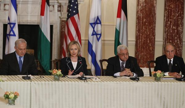 Former Secretary of State Hillary Clinton is seated with (left to right) Israeli Prime Minister Benjamin Netanyahu, Palestinian President Mahmoud Abbas and former Special Envoy for Middle East Peace George Mitchell as she hosts the relaunch of direct negotiations at the State Department in Washington, Thursday, Sept. 2, 2010. (Charles Dharapak/AP)