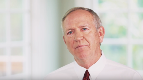 State Sen. John Doll in a Greg Orman campaign video.