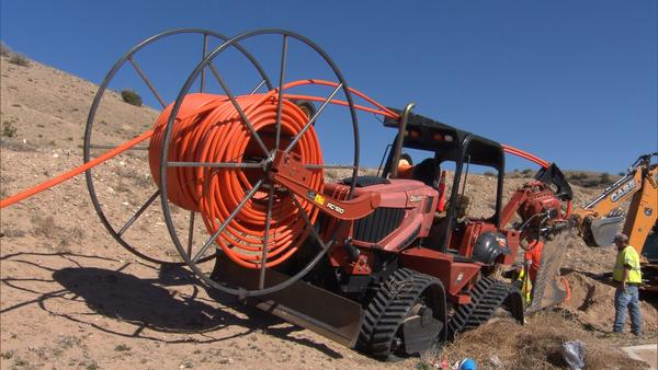 Crews install the final stages of a new fiber-optic internet network across four tribal nations in northern New Mexico.