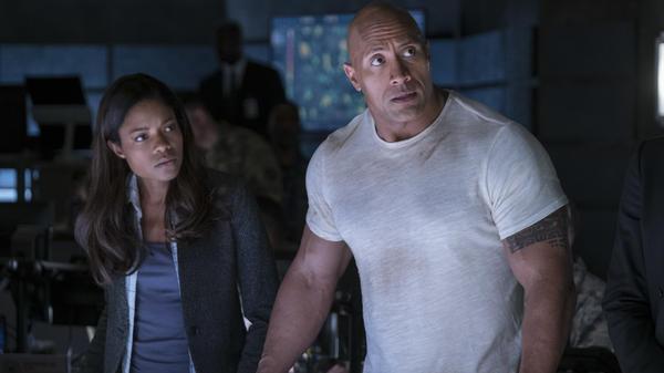 Naomie Harris and Dwayne Johnson battle giant mutant monsters in <em>Rampage. </em>