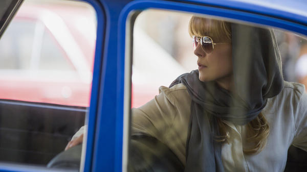 Rosamund Pike plays a U.S. operative who helps Jon Hamm's diplomat in the political thriller <em>Beirut. </em>
