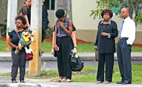 Mourners leave the funeral for Aaron Feis on Thursday.