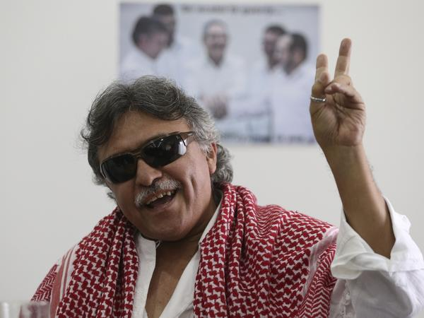 Revolutionary Armed Forces of Colombia (FARC) rebel commander Jesus Santrich flashes a victory hand signal at the end of a news conference in Bogota, Colombia, in 2016.