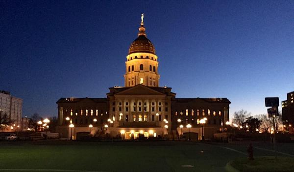 Lawmakers are considering making people who peddle influence with the Kansas executive and judicial branches register their activities the same way legislative lobbyists do.