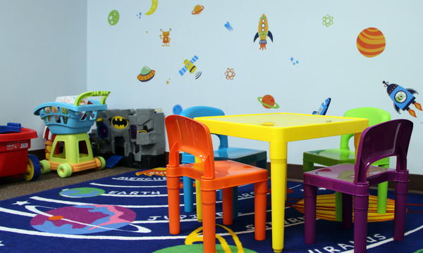 A kid-friendly room in KVC's Topeka office is decorated with a space theme. The contractor is used to having kids hanging out in kid-friendly spaces of its offices, but is still adjusting to a growing number of children spending nights there.