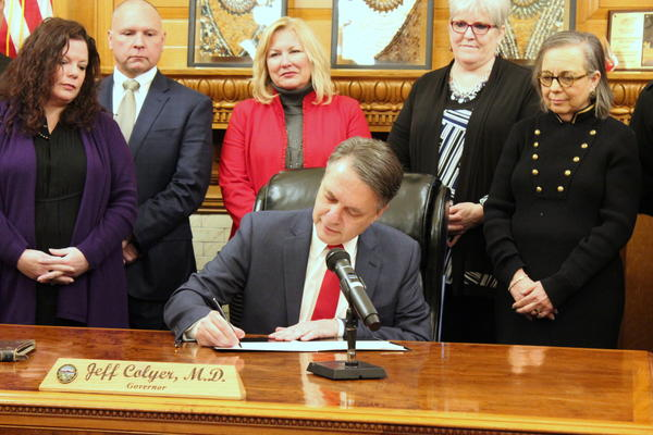 Kansas Gov. Jeff Colyer signs his first executive order, a measure to fight sexual harassment.