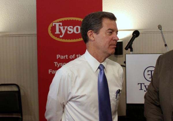 Gov. Sam Brownback attended a September event unveiling a planned Tyson facility near Tonganoxie. That plan was later put on hold.