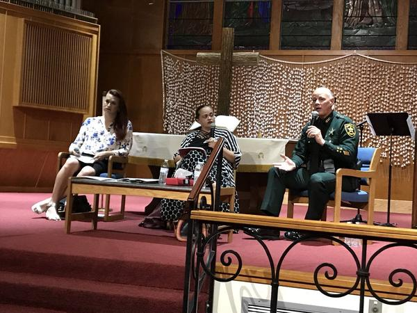 Immigration Advocate Isabel Sousa, immigration attorney Mayra Calo and Pinellas County Sheriff Bob Gualtieri debate the ICE-Florida Sheriff's Partnership agreement that went into effect in January.