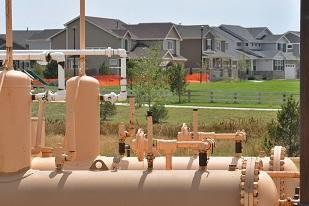 In places like Thornton, Colo., oil and gas facilities sit within a few hundred feet of suburban homes.
