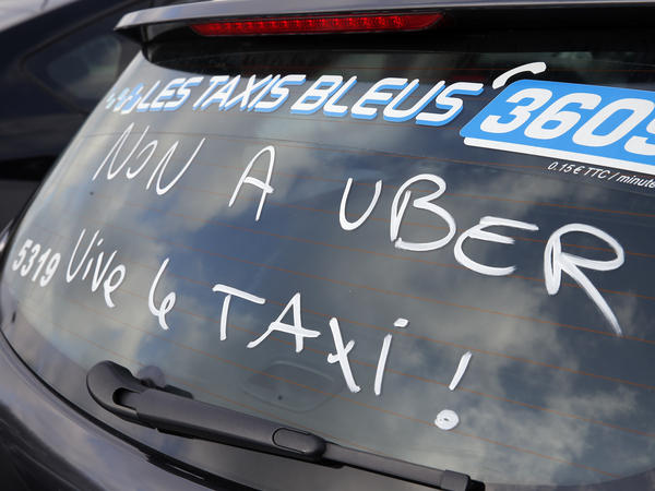 During a January 2016 blockade in Paris, taxi drivers complained of unfair, less-regulated competition from services such as Uber. The EU's top court ruled Tuesday that France can bring criminal charges against Uber for organizing ride networks.