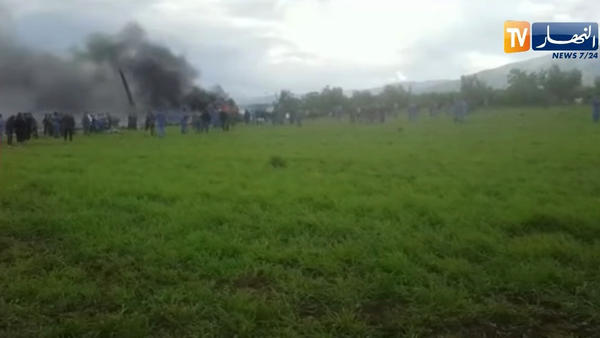 Smoke rises from the spot where an Algerian military plane crashed into a field in northern Algeria on Wednesday, in this still image taken from Ennahar TV.