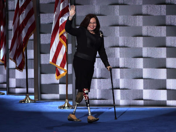 Sen. Tammy Duckworth walks across stage at the Democratic National Convention in 2016. She is the first senator to give birth while serving in office.