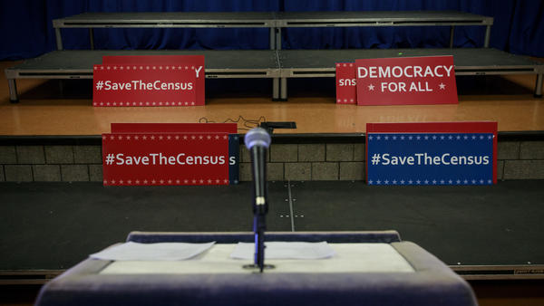 Signs sit behind the podium before the start of a press conference in New York City about the multi-state lawsuit to block the Trump administration from adding a question about citizenship to the 2020 census form.