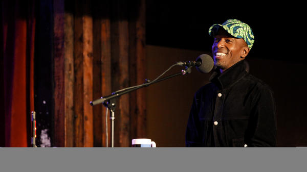 Ntare Guma Mbaho Mwine appears on Ask Me Another at the Bell House in Brooklyn, New York.