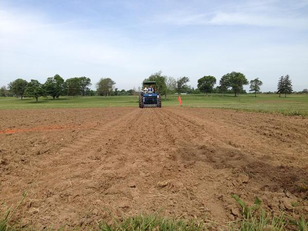 A plot seeder plants hemp seeds the University of Kentucky's hemp research plot on May 14, 2015.
