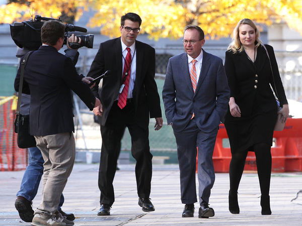 Mick Mulvaney arrives at the Consumer Financial Protection Bureau on Nov. 27, 2017, after being named director by President Trump. Mulvaney's appointment is being challenged in court by Leandra English, who had been appointed to that position by outgoing Director Richard Cordray.