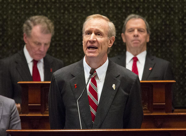 Gov. Bruce Rauner delivers his 2017 budget address in the Illinois House, flanked by House Speaker Michael Madigan, left, and Senate President John Cullerton, right.