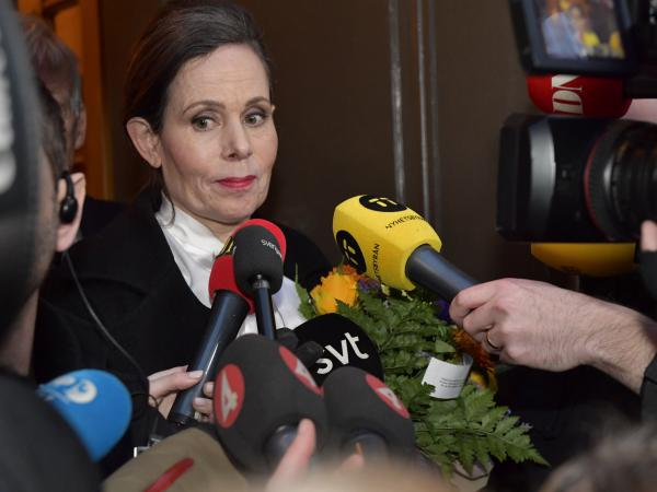 The Swedish Academy's Permanent Secretary Sara Danius talks to journalists as she leaves a meeting at the Swedish Academy in Stockholm, Sweden, on Thursday.
