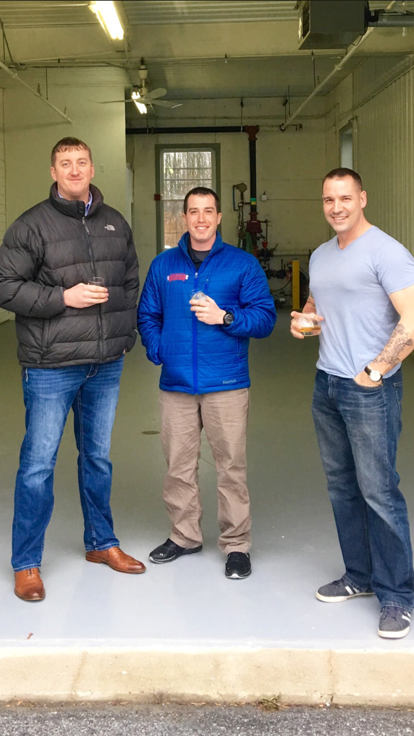 Having served together in Afghanistan, Zac Fike (L), Matt Kehaya (middle) and Steve Gagner (R) are using this industrial garage to barrel their first batches of bourbon from their new venture: Danger Close Craft Distilling.