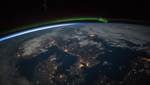 Astronauts aboard the International Space Station took this image of southern Scandinavia, showing the northern lights aurora, just before midnight under a full moon on April 3, 2015.