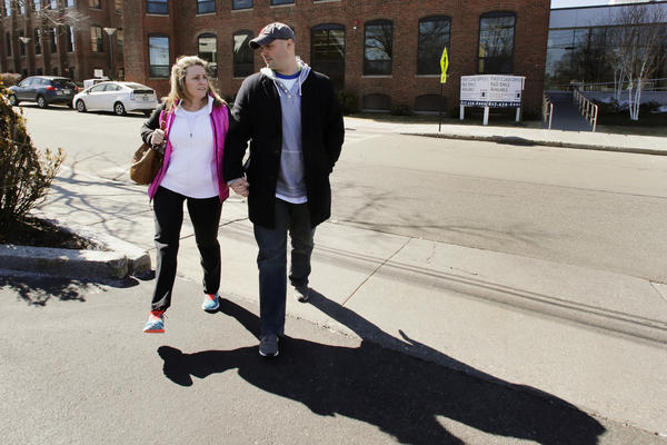 Sdoia walks with Boston firefighter Mike Materia in 2014 after a doctor's appointment in Newton, Mass. She and Materia are now married.