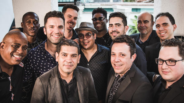 "The members of Orquesta Akokán hail from both Cuba and the U.S., assembled by vocalist and composer José ""Pepito"" Gómez. They recorded their debut album live to tape in just three days."