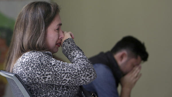 Relatives of the three men react in anguish as Moreno confirms their deaths Friday.