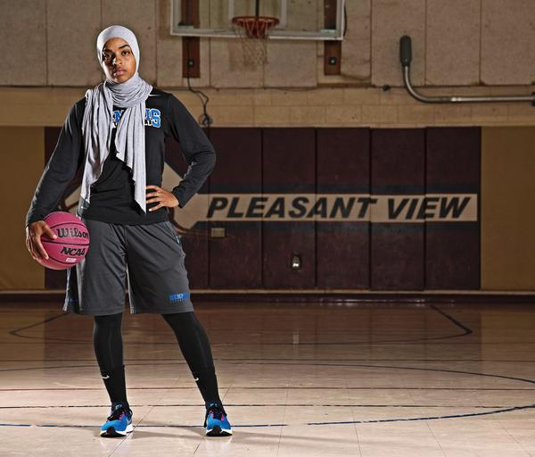 Bilqis Abdul-Qaadir, seen in a photograph for the NCAA<em> Champion</em> <em>Magazine</em> last year, was the first Muslim woman in a headscarf to play NCAA Division I basketball.