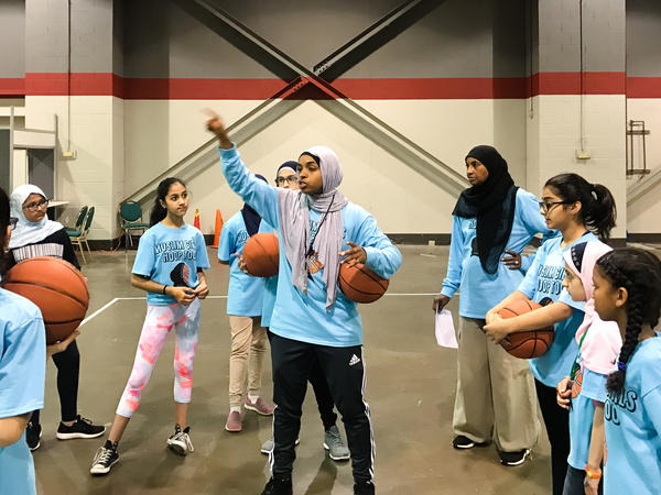 Bilqis Abdul-Qaadir runs a basketball clinic for girls at the Islamic Society of North America Convention in Chicago in 2017.