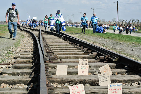 Survivors and the descendants of victims arrive at Birkenau and leave messages in the train tracks for those who perished in the Holocaust.
