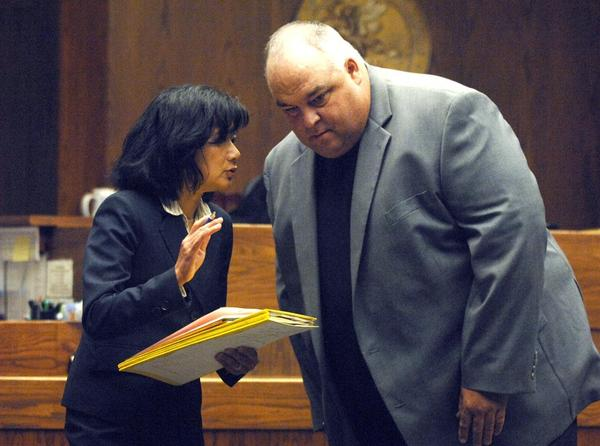 Former Coliseum general manager Bart Rogers with his attorney, Stephanie Wong, during a 2017 court appearance.