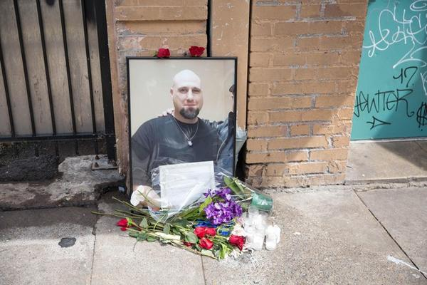 <p>Extinguished candles, bouquets of flowers and a large photo of him with his name — remained on the sidewalk outside the Cityteam Ministries Shelter Mondaymorning.</p>