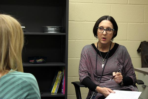 Butler County school psychologist Julie Watkins talks with a teacher about concerns she has about one of of her students.