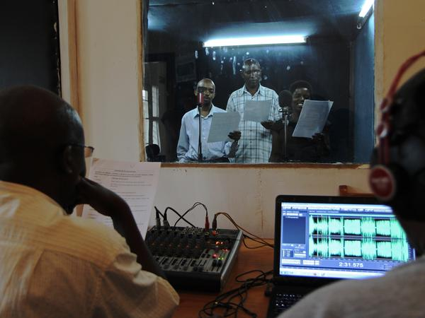 "Actors reading during the recording of an episode of the soap opera ""Musekeweya"" in Kigali, produced by the NGO <a href=""http://www.labenevolencija.org/"">Radio La Benevolencija.</a> Twice a week and for half an hour, everything stops on the hillsides of Rwanda as people huddle around a radio and listen to a soap opera that aims to heal the wounds left by the genocide."