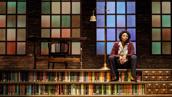 Sharon Washington on stage in her play <em>Feeding the Dragon</em>, about her childhood in a library.