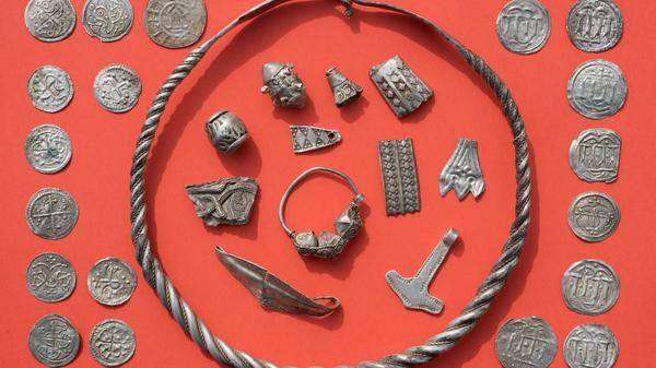 "Tenth-century silver items are pictured on a table in Schaprode, northern Germany, on Friday. A 13-year-old boy and a hobby archaeologist have unearthed a ""significant"" trove in Germany which may have belonged to the legendary Danish King Harald Bluetooth."