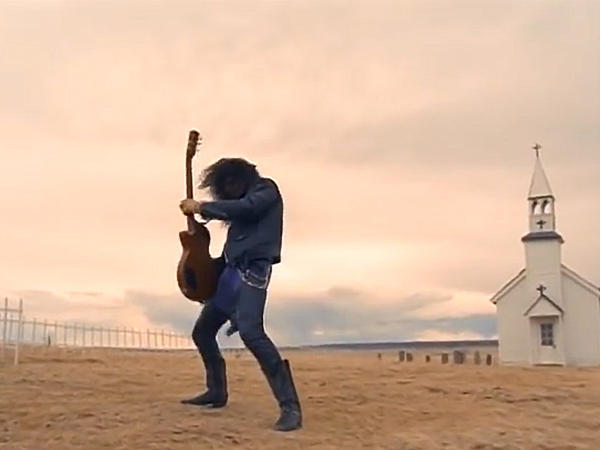 "Slash performs his epic guitar solo in the Guns And Roses video ""November Rain."""