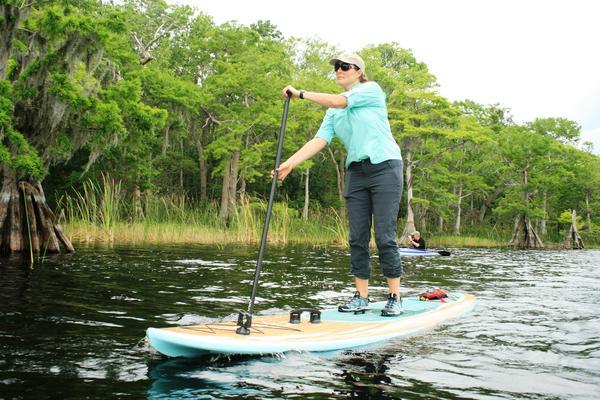 Mallory Lykes Dimmitt paddles Lake Russell
