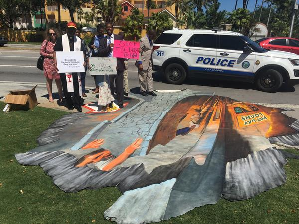 The protest featured 3-D sidewalk art denouncing payday lending.